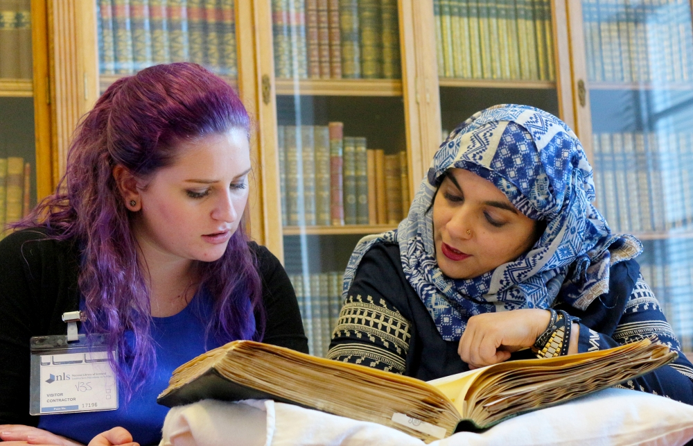 youth workers Becca and Fozzia working at the National Library of Scotland